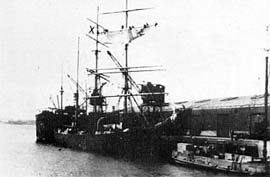 Barque James Craig, Auckland. Bending the fore t'gans'l. I am on the starboard yardarm - the one farthest from the wharf.