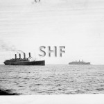 AQUITANIA and QUEEN MARY off Fremantle 1941. SHF Coll.