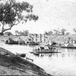 Bourke with barges, paddlers and punt between 1880 and 1894.