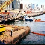 Darling Harbour with crane lifting sunken boat. 1992.