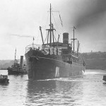 MATARAM, 1909-1934, sunk 1943. with tugs. SHF Coll.