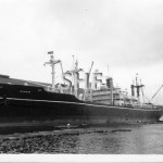 NANKIN 1945 with lograft and B and J Co. tug. SHF Coll.