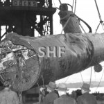 TITAN lifts remains of Jap. midget sub, 1942. SHF Coll.