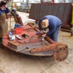 "John Oxley rudder repairs - grinding the join after oxxy torch ""gouging"""