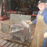 Volunteer Brian Beer welding a replacement sea inlet box for JO built in the SHF workshop