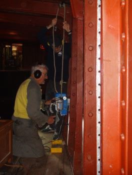 Martyn drilling holes in the ship